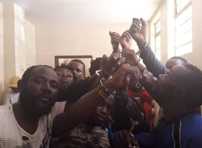 LGBTI refugees in Kenya protest in handcuffs. (Photo courtesy of Refugee Flag Kenya via Facebook)