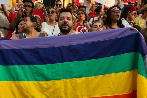 Tunisian gay-rights leader flees to France for safety