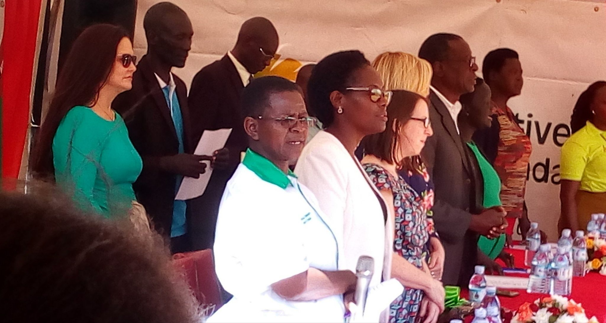 Stella Kentusi, executive director of NAFOPHANU (first from left in white t-shirt) at the launch of the report flanked by other dignitaries. (UhspaUganda photo)