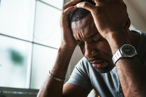 A black man in stress -- a photo illustration.