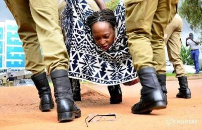 Dr Stella Nyanzi, a Ugandan LGBT ally and human rights defender, is whisked away by police after arrest during a recent protest demanding food for women during the Covid-19 lock-down. (Photo courtesy of Reuters)