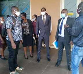 Adrian Jjuuko (second from right), executive director of HRAPF, after filing lawsuit accusing Ugandan officials of torture. (Photo courtesy of Children of the Sun Foundation via Facebook)