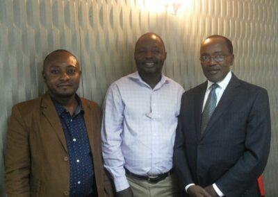 Moses Kimbugwe from Spectrum Uganda (left), current Key Populations representative on the Global Fund CCM panel; Kikonyogo Kivumbi (center) of UhspaUganda; and Dr. Joshua Musinguzi (right), AIDS control programme manager at the Ugandan Ministry of Health.