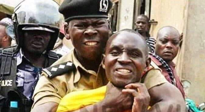 A Uganda police officer strangles an unarmed suspect. (Photo courtesy of New Vision)