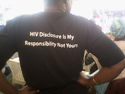 "A Ugandan activist displays a message about mandatory disclosure in Uganda's HIV/AIDS Prevention and Control Act . <a href=""https://www.newvision.co.ug/news/1430201/contentious-hiv-aids-law-clauses-activists"">Activists are still contesting sections of the act that they consider unfair in the constitutional court.</a> (UhspaUganda photo)"