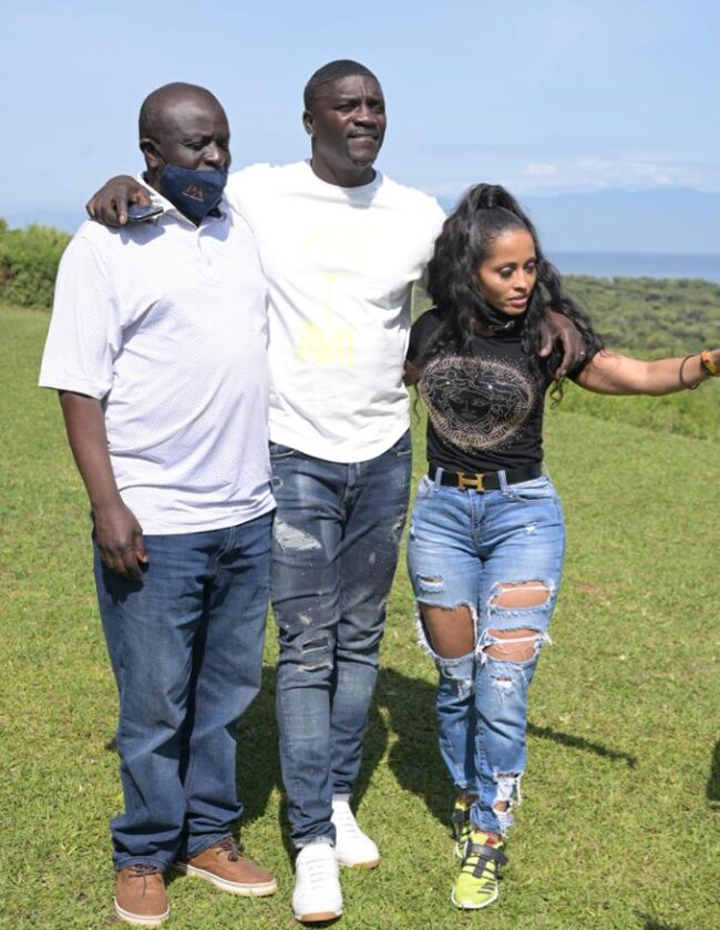 Uganda's senior presidential advisor, Abbey Walusimbi (left), with Akon and his wife in Queen Elizabeth National Park in western Uganda. (Photo courtesy of Nile Post)